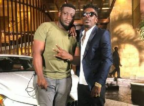Shatta Wale presents new BMW 5 Series to his manager as birthday gift