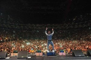 Nigerian Singer 'Wizkid' Fights His Bodyguards On Stage At London For Trying To Prevent His Fan From Hugging Him (Video)