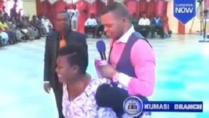 Video: Lady carries Obinim at her back after his precise prophecy her