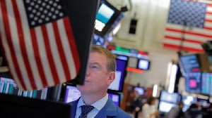 US markets hit record highs as investors interpret trade news
