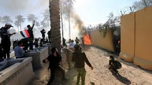 US embassy in Iraq 'stormed' by protesters angry at air strikes on militia